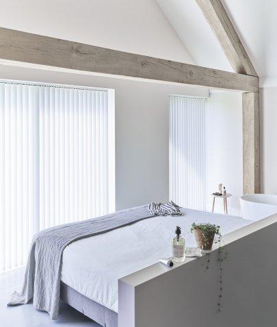 Een slaapkamer met hotelallure
